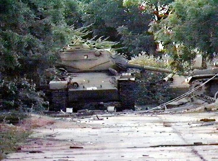 Three knocked-out Somali National Army (SNA) M47 Patton medium tanks left abandoned near a warehouse following the outbreak of the civil war.