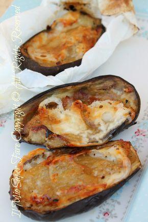 Melanzane al cartoccio con scamorza ricetta facile, saporita e leggera. Grande effetto scenico per il suo cartoccio che garantisce una cottura uniforme