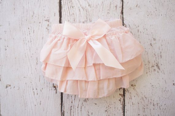 Ruffle Butt diaper covers are a must for all Peanuts to have in there closets! adorned with a satin bow and ready to wear under anything fabulous!