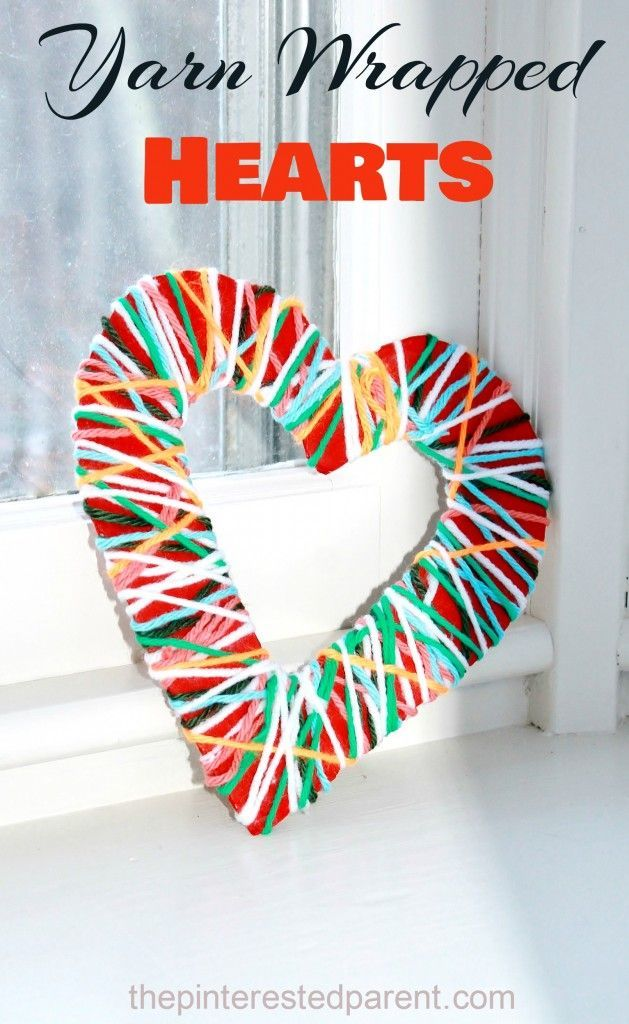 A pretty fine motor activity and kid's art and craft project for Valentine's day Yarn Wrapped Hearts