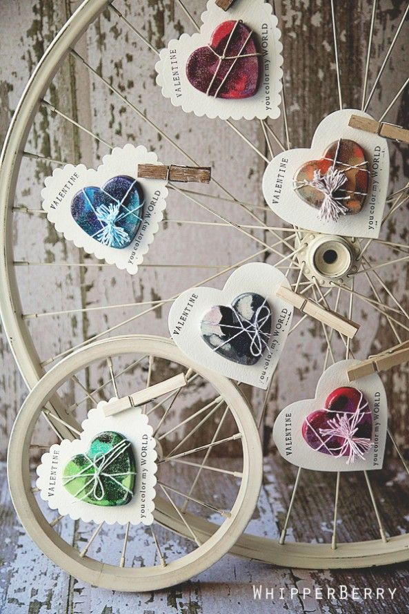 Homemade heart crayon Valentines - I think I love the way they are displaying them even better than the actual valentines! So - old bicycle wheel and clothespins is another idea for displaying photos, etc.