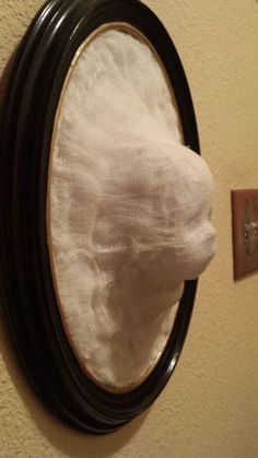 Cool Halloween décor. Buy styrofoam mannequin head from Value Village. Glue on cheesecloth and paint if needed.