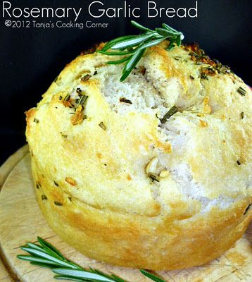 Rosemary Garlic Bread    Ingredients (makes 2 loaves)    Dough:  1 kg of all-purpose flour  1 pack active dry yeast  1,5 teaspoon salt  500-550 ml of lukewarm water    Spices for the topping:AND Inside!!!  2 cloves of garlic  2 teaspoons of chopped fresh rosemary  4 tablespoons olive oil