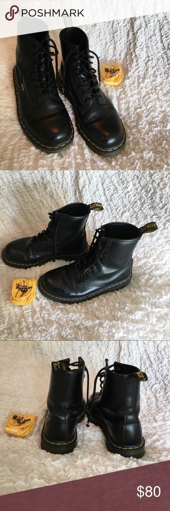 Dr. Marten Air Wear Black Boots Gently worn Dr. Marten Air wear black lace up boots. Never used yellow original laces are included as well. Dr. Martens Shoes Combat & Moto Boots