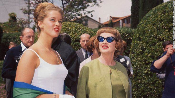 """Davis attends the Cannes Film Festival with her oldest daughter, B.D., in 1963, where she saw """"Baby Jane"""" for the first time. Like Christina Crawford, B.D. Hyman would write an unflattering book about her mother. Unlike """"Mommie Dearest,"""" """"My Mother's Keeper"""" was published when its subject was still alive. Davis, who was recovering from a stroke, was devastated by what she saw as her daughter's betrayal and disinherited her."""