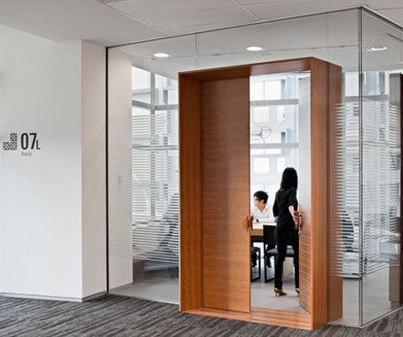 Nicely detailed door in frameless glass partition American Express Singapore
