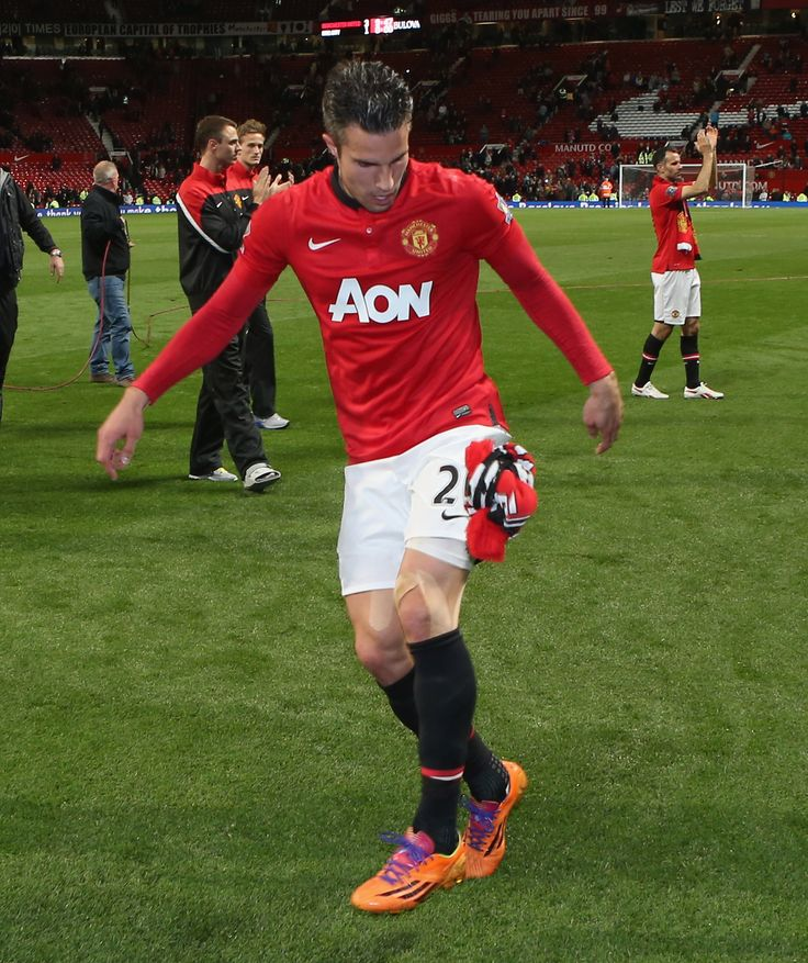 Robin van Persie of @manutd shows off his skills to the Old Trafford crowd using a scarf thrown to him by a supporter.