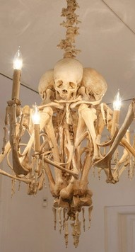 Skull chandelier.  I read a fairy tale that told of a house made of bones.  I imagine they would have a fixture like this.  A bit creepy for everyday, but perfect for Halloween...