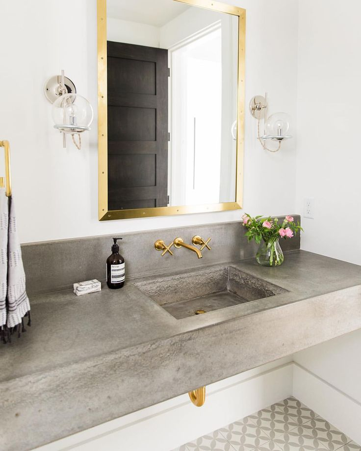 Concrete and gold bathroom.   See this Instagram photo by @studiomcgee