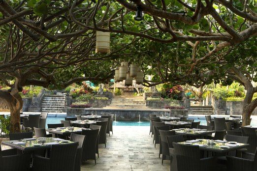 Cozy restaurant: The Kemangi Bistro has tables in an outdoor area conveniently shaded by sea grape trees. (Photo courtes...