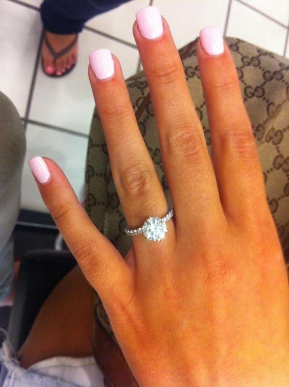 Perfection!! CIRCLE DIAMOND WITH THE BAND HAVING TINY DIAMONDS!! :)