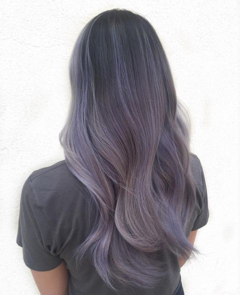 If you like ombre styles and unnatural shades, we've got a beautiful new hair color for you: smoky lilac. As seen in this sweeping look by hairstylist Kendall Noel, smoky lilac hair transitions from a deep grayish purple down to a pale, foggy lavender. The result: a mysterious, unique shade that looks especially lovely on longer hair.