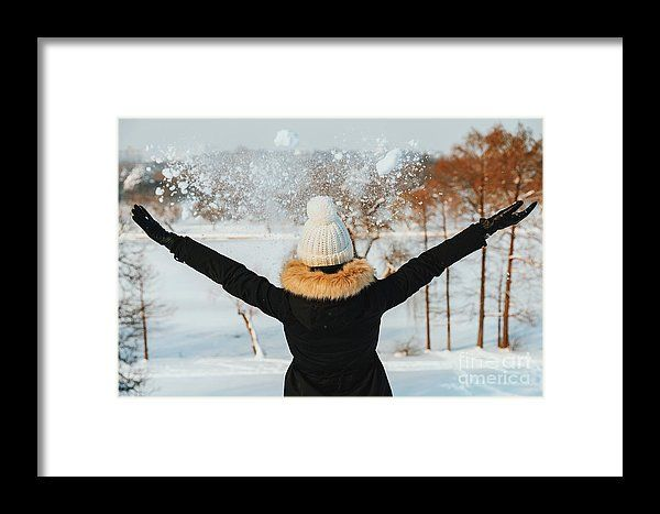 Girl Throwing Snow In Air During Winter Framed Print