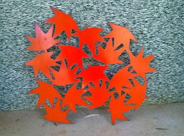 Plasma cut autumn leaves I cut from a metal drum lid.