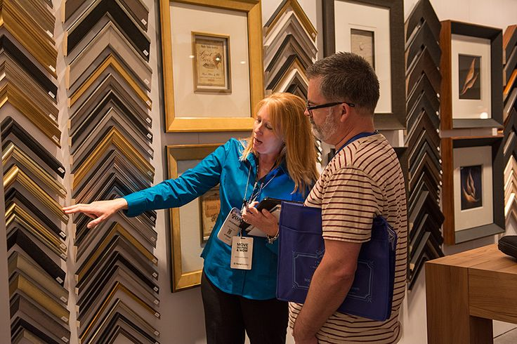 Jan connects with a partner at #WCAF15 to show up some of our moulding! #ChoosePowerfully