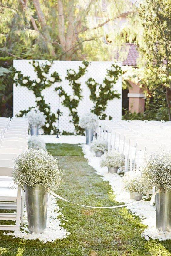 rustic baby's breath wedding aisle decor idea   / http://www.himisspuff.com/rustic-babys-breath-wedding-ideas/5/