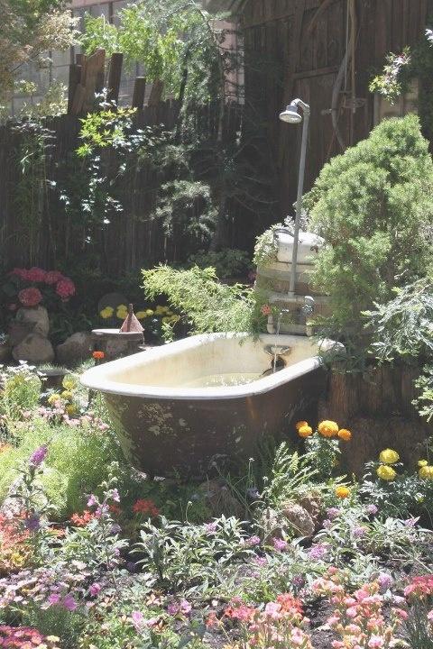 clawfoot bathtub garden pond