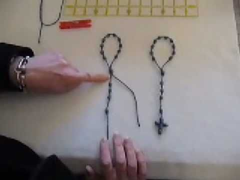 Helpful video on how to make a rosary knot.  She uses a clothespin which is helpful.