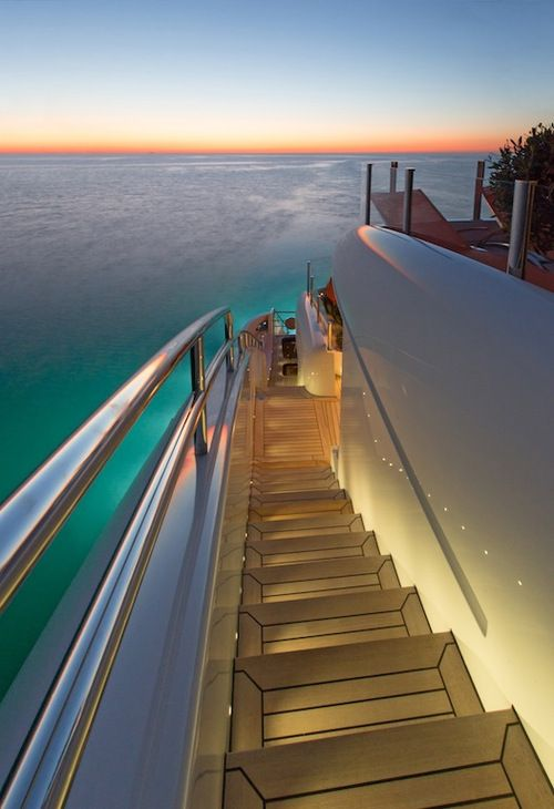 """Mega yacht""""s lit outer stairway - can you image yourself walking down it in a long gauzy evening dress/or light shirt and white chinos, with a beverage in your hand ? Yikes!"""