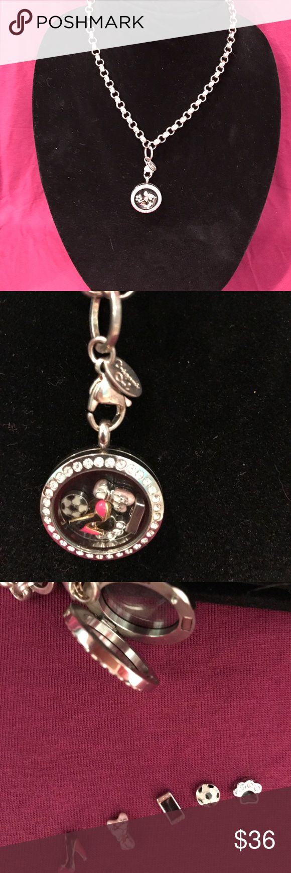 Origami owl necklace Origami owl necklace with 5 charms. High heel , paw print, soccer ball, ballet slippers, cell phone. Jewelry Necklaces
