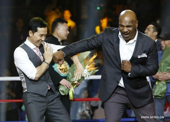 "DO BUSINESS AND TRADE WITH THOSE WHO DO NOT HATE YOU FOR THE COLOR OF YOUR SKIN! (1/4)Former heavy weight world champion Mike Tyson attends a press conference of the film ""Ip Man 3"" in Shanghai, east China, May 6, 2015. Mike Tyson is expected to play a role in the film. (Xinhua/Ding Ting) Former heavy weightworld champion Mike Tyson (R) and actor Donnie Yen interact with each other during a press conference of the film ""Ip Man 3"" in Shanghai, east China, May 6, 2015. Mike Tyson is expected…"