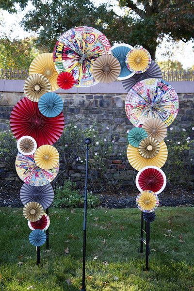 Unique wedding ceremony decor idea - colorful paper pinwheel rosettes made with copies of comic books! {Bellemore Photography}