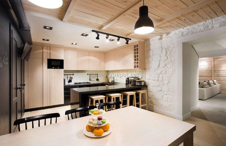 Interesting ceiling treatment and a way to hand laundry room cabinets over a brick wall.