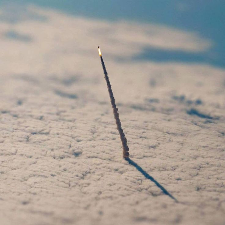 This is the pic of a space shuttle leaving our atmosphere taken from space by NASA. Amazing isn't it. And how nano are we in the cosmic scale