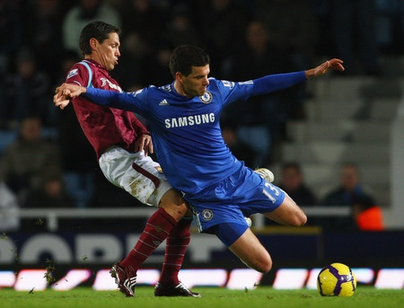LONDON, ENGLAND - DECEMBER 20: Guillermo Franco of West Ham United challenges Michael Ballack of Chelsea during the Barclays Premier League match between West Ham United and Chelsea at Upton Park on December 20, 2009 in London, England.