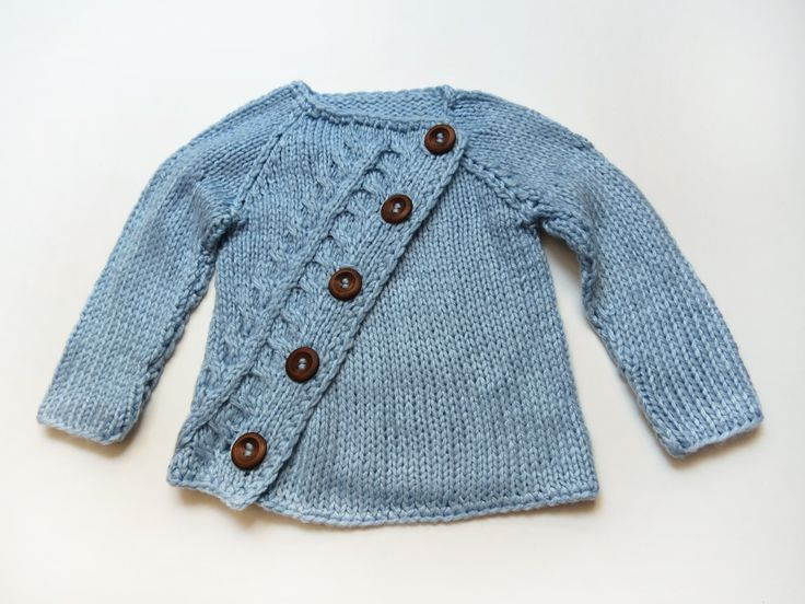 Assymetric baby sweater. Etsy.