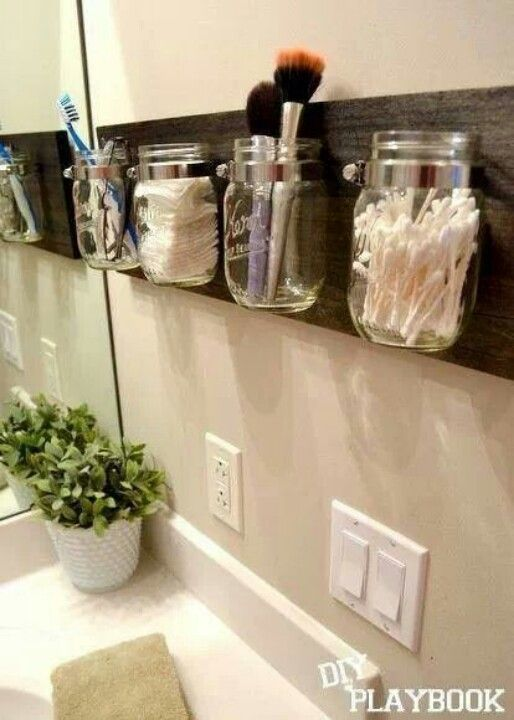 double sinks, two mirrors over each, floating shelves inbetween mirrors, mason jars for storage