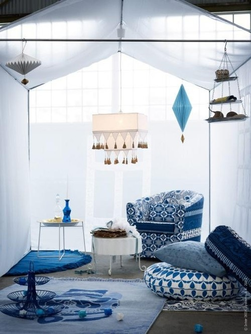IKEA pieces go Moroccan in this monochromatic patio. We love the floor cushions and think a white coffee table would be a great addition to let you entertain in this space