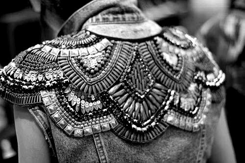 Embellished jacket back with structured pattern; sewing inspiration; close up fashion design detail