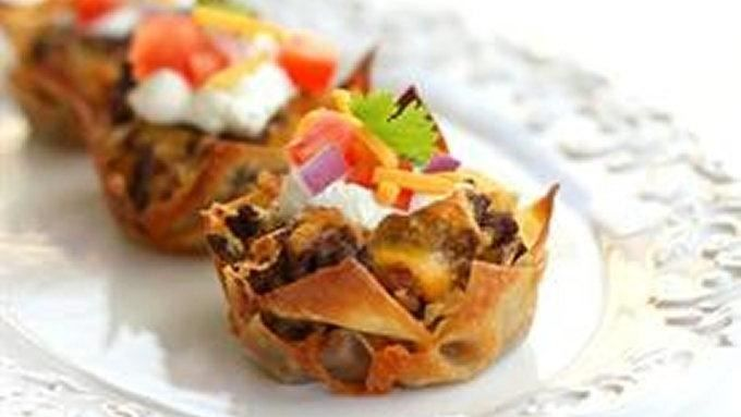 Yummy layers of your favorite taco fillings baked in wonton wrappers in cupcake form.