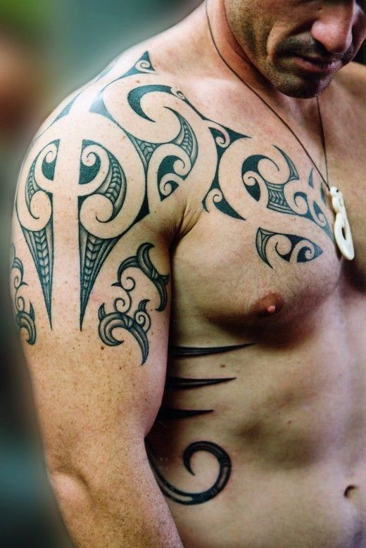 Amazing shoulder/chest/side body tribal tattoo. One of few large body tattoos that I've seen and loved! (it doesn't hurt that the guy wearing it isn't half bad looking too (; )
