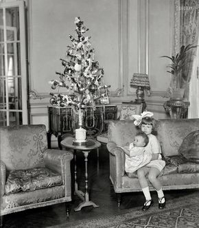"""December 26, 1924. Washington, D.C. """"Nevine and Nemai Yousry."""" Children of the Egyptian ambassador and their Christmas tree."""