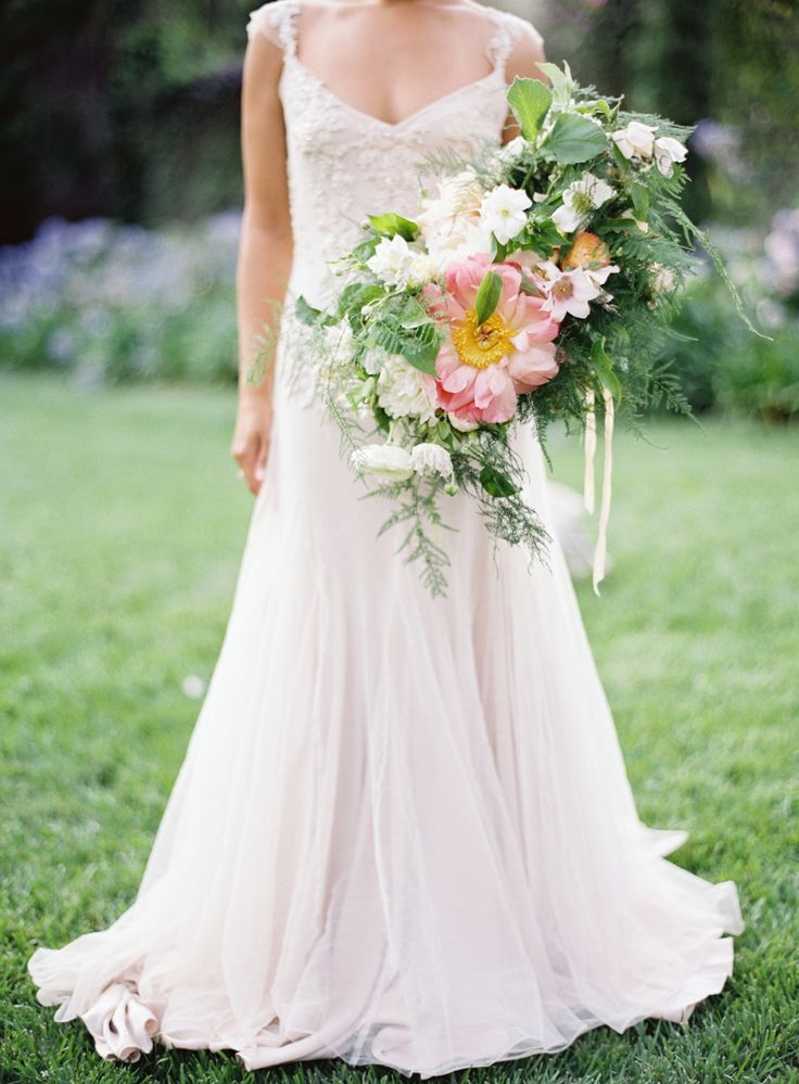 Wedding Gown Designer talks about planning the perfect #RusticWedding on SMP: http://www.StyleMePretty.com/2016/04/03/a-bridal-designer-shares-tips-every-rustic-bride-needs-to-read/ Wedding Dress : Sarah Janks  | Photography : Jose Villa | Floral Design : Poppies And Posies
