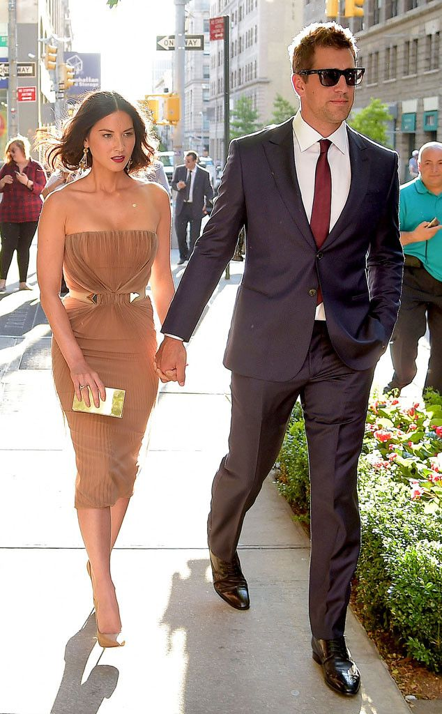 The actress' new NFL quarterback boyfriend escorts her to the NYC premiere of her latest film, Deliver Us From Evil.