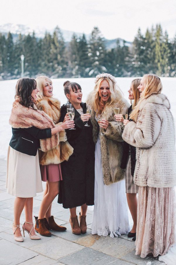 Mismatched bridesmaid dresses are popular, but what about mismatched wedding accessories? This winter bridal party rocked this stylish trend using faux fur vests! | Faux Fur Inspiration for Brides and Bridesmaids