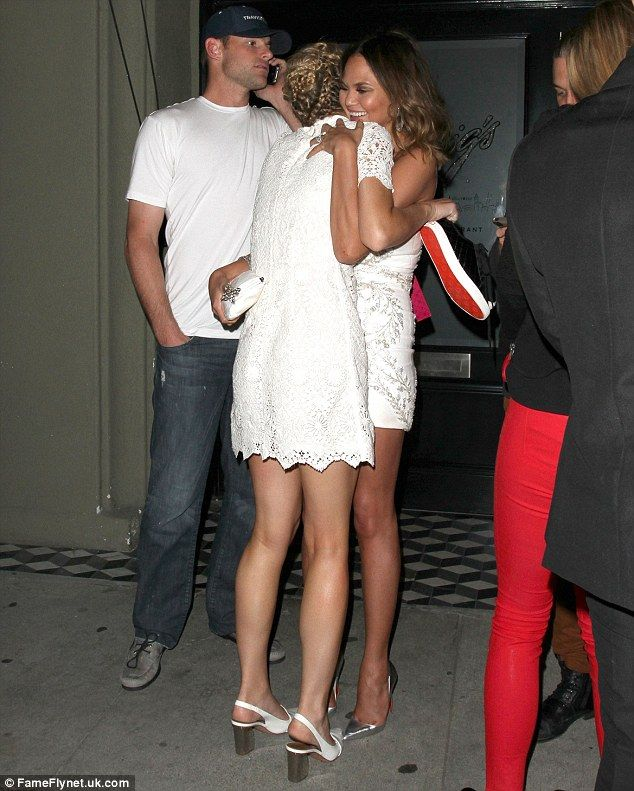 Hugs: As the couple left the restaurant they bumped onto Andy Roddick and Brooklyn Decker
