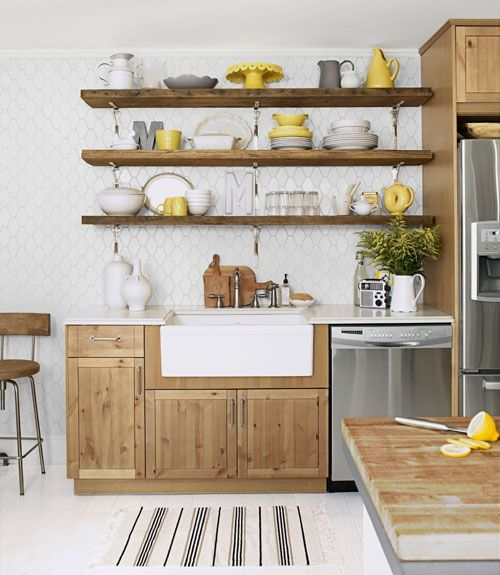 Love the open shelving and the wooden accessories, but I especially love the faucet and farmhouse sink