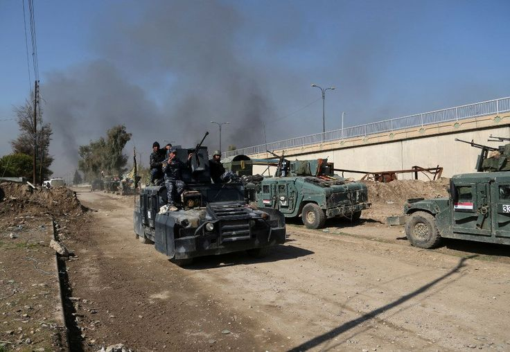 Iraqi forces storm Mosul government complex, then pull back | en portugal es mas