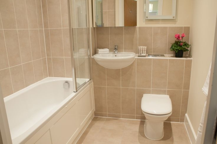Marble effect tiling complete the bathrooms
