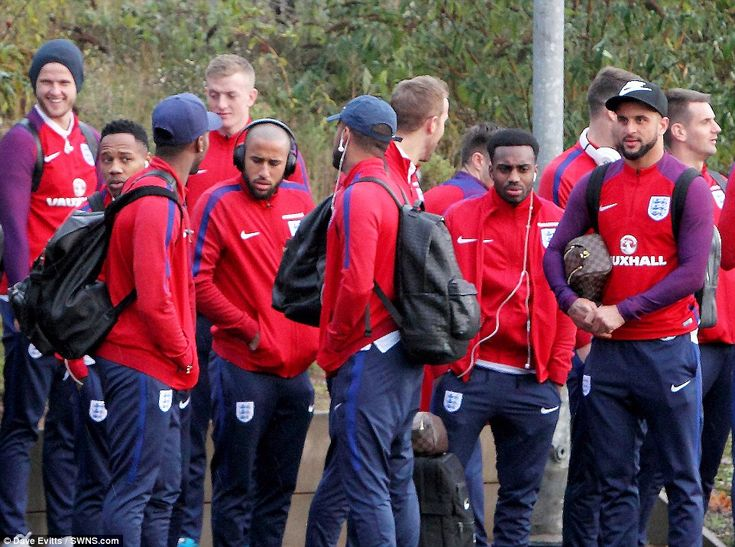 Andros Townsend (centre left), Danny Rose (centre right) and Kyle Walker (right) wait pati...