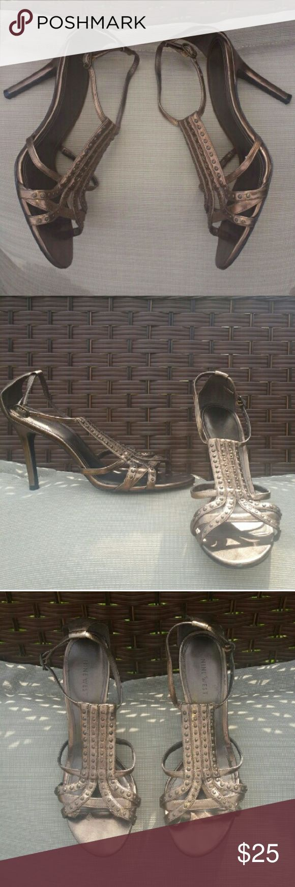 Bronze Strappy High Heel Sandals Bronze metallic strappy high heel sandals. Size 8 M. 4 inch heel. Brand: Nine West (Style: Sizzle). Adjustable buckle strap and heel strap for comfort fit. Great condition. Wear with dresses or jeans. Looks great with red, black, navy, denim and white. Nine West Shoes Heels