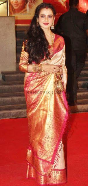Rekha. off white pure kanjeevaram zari saree with pink border.