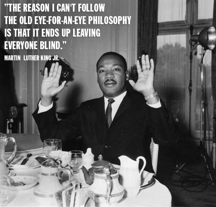 """This arresting photo and quote by civil rights icon Dr. Martin Luther King still resonates today as """"Hands up, don't shoot!"""" became the slogan of those protesting the death of Michael Brown in Ferguson, an unarmed black teenager who was fatally shot by Missouri police officer Darren Wilson."""