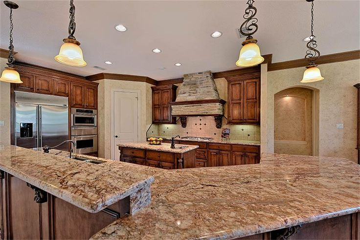 63 Quail Rock Pl The Woodlands, TX 77381: Photo Amazing rustic brick vent hood & 5 burner gas cooktop! Thermador oven, warmer drawer & microwave oven.  2 S/S undermount sinks w/small vegetable sink in island!  Huge pantry! Built-in GE Monogram S/S refrigerator! S/S KitchenAid 2 drawer dishwasher!