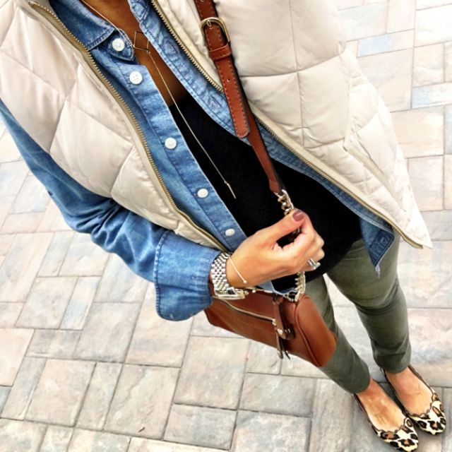flats, olive jeans, black tee, chambray button-down, white puffer vest, cross-body bag, long necklace