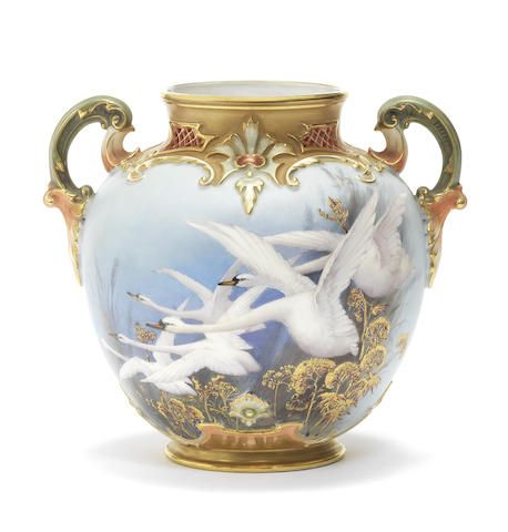 A Royal Worcester vase by Charley Baldwyn, dated 1899 Of ovoid shape with twin handles picked out in coral, green and gold, the scroll-moulded border pierced with lattice panels, painted with five swans in flight reserved on a sky-blue ground, signed C Baldwyn, the reverse with swallows in a particularly vivid bright blue heightened with gilding. Sold for £1,750